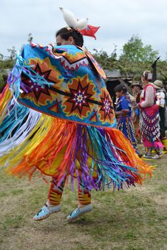 Fancy shawl dancer: impressive dancer. Sure beats the floats like a butterfly quote from years ago. Shawl dancers imitate butterflys in flight. Photo taken at Maniwaki, PQ