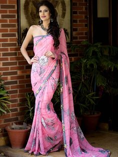 Engrossing pink color Georgette Saree with floral print. Item Code : SMNA1150 www.bharatplaza.com/new-arrivals/sarees.html