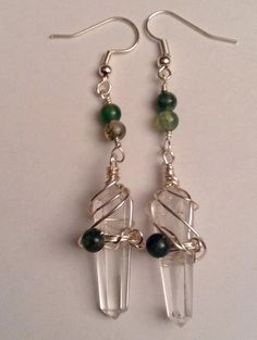 Hand wrapped Quartz Crystal double swirl earrings with Moss Agate accents.