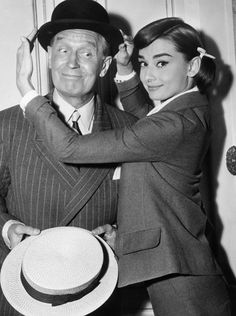 "Audrey Hepburn with Maurice Chevalier during the filming of ""Love in the Afternoon"" (1956)."