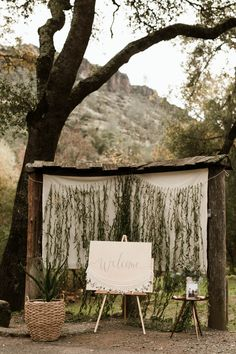Modern rustic reception welcome area with sign | Image by Briana Morrison