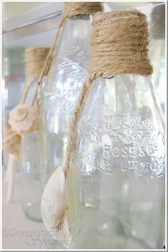 Twine wrapped bottles with dangling shells - an easy DIY project!