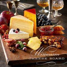 A Wisconsin cheese board for the winter months! Featuring cheddar, parmesan, brie and edam cheese. Find the full pairing tips here: http://www.wisconsincheesetalk.com/2015/01/16/winter-cheese-board-wisconsin-recipe-how-to/