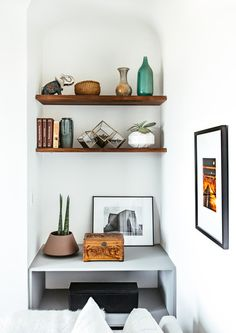 """The entryway is a perfect introduction to the classic, yet fresh design of Dewell's home. """"We wanted to preserve the architectural details (original hardwood floors and molding), but also add some less traditional elements that are more reflective of Ben's style —clean lines, comfortable, and modern,"""" saysHarmatz."""