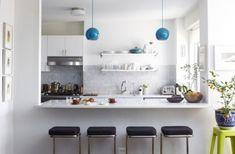 white + marble + open shelving + blue pendants