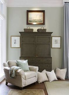 Painted vintage armoire in a serene, muted living room found on Decor Pad.want one in my bedroom Coastal Living Rooms, Home And Living, Living Spaces, Apartment Therapy, Vintage Armoire, Antique Chest, Gray Painted Walls, Gray Walls, Painted Chest