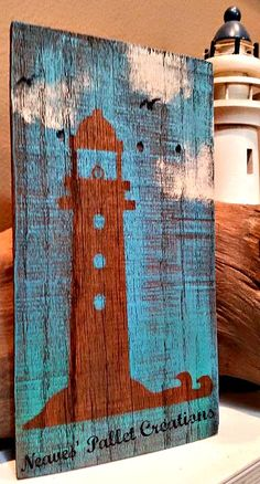 """RECYCLED WOOD PALLETS: Recycled pallet boards used again in our """"Coastal/Beach"""" themed wall hanger/shelf sitter. This lighthouse is 11"""" x 6"""" and is being offered for $6. It is painted bright blue with hints of Emerald green. Message us if you would like this one-of-a-kind item. Item # 618"""
