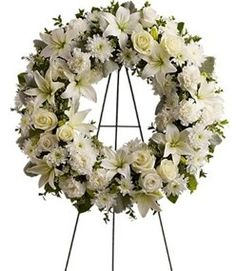 There are numerous options for funeral wreaths. This one incorporates the traditional lilies.