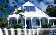 Bright shutters, picket fence, gingerbread trim