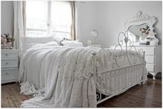 This room is gorgeous, I love the disheveled linens...but I'd love it so much more if that iron bed was dark cast iron...all white rooms, to me, always seem to be missing something to ground them...