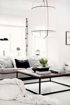 Make a white-and-black color palette pop by mixing textures throughout the room.   - HarpersBAZAAR.com