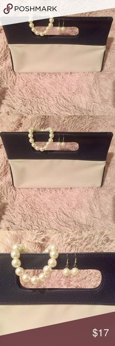 Clutch Purse and Faux Pearl Set Clutch Purse and Faux Pearl Set. 👛 Purse is Medium in size with colors of Navy Blue and Cream. 1 Pair Of Earrings & 1 Bracelet UNBRANDED Bags Clutches & Wristlets