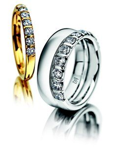 Meister<p> Yellow gold wedding ring set with 7x Diamonds 0.350 G-VS<p> White gold wedding ring   <p> White gold wedding ring set with 11x diamonds 0.990 G-VS