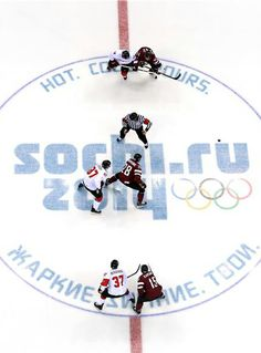 Sidney Crosby of Canada and Zemgus Girgensons of Latvia face off in the first period during the Men's Ice Hockey Quarterfinal Playoff on Day 12 of the 2014 Sochi Winter Olympics  Canada won giving them a spot in semi-finals, where they will meet the rival Americans for a berth in the gold-medal game.