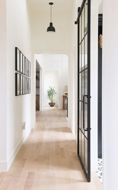 oak floors + white walls + black door