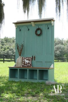 Re Use Old doors, wood bench, shelf and some hooks to create your own mud room furniture.