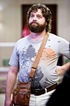 Alan carries a satchel and so does Joy Behar.