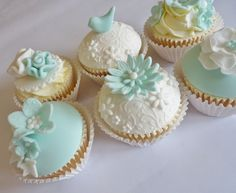 Pretty cupcakes - SO love the colours and that cute little birdie!
