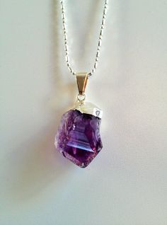 """Trend: Raw Crystal / Gem stone jewelry This is not for everyone. If your gems need to be """"perfect"""", then pass this by. Link has some good pics of rough gemstone jewelry. I happen to love the stuff and hope it truly is a trend. Crystal Jewelry, Crystal Necklace, Gemstone Jewelry, Amethyst Necklace, Gems Jewelry, Jewlery, Purple Jewelry, Jewelry Accessories, Earrings"""