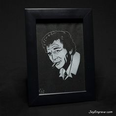 Actor Peter Falk as Lt Columbo. This glass engraving was done by hand using a micromotor and took 6 hours to complete. Hand engraved and framed with black fabric inside. Frame Size: 6 x 4 (Inches) Frame Color: Black Frame Material: Wood Like all my engravings, each one is unique, individually numbered, initialed and comes with a JayEngrave COA. Catalogue Serial Number: 30-02-46 Looking for gift ideas? These framed hand engravings make ideal Xmas and Birthday gifts for any Peter Falk… Glass Engraving, Hand Engraving, Actor Peter, Peter Falk, Frame Sizes, Framing Materials, Black Fabric, Initials, Birthday Gifts