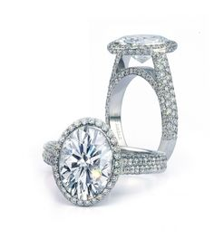 Bez Ambar oval diamond in diamond pave halo setting.  Available at Alson Jewelers.