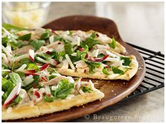 A white bbq sauce acts as the base for this pizza a top a flakey cracker thin crust.  Topped with fiji apples, pulled chicken strips and spinach.