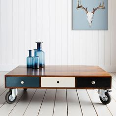 With 5 useful drawers in a mishmash of styles, this wooden coffee table has large casters and is highly versatile.    4 Small Drawers: 37.5cm (W) x 37.cm (D)  1 Large Drawer: 77cm (W) x 37.5cm (D)