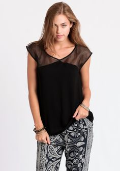 Black sleeveless blouse with sheer organza detail at the yoke and back.