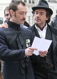 """Jude Law and Robert Downey Jr. on the set of """"Sherlock Holmes."""""""