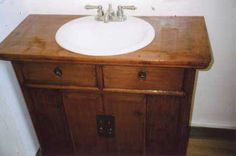 We sold our customer an old Chinese sideboard and he cut a hole and used it for his guest bathroom sink.  Custom furniture from www.SanDiegoRustic.com