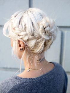 Platinum blond side braid into braided bun.
