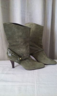 New (never used) - New without the box  Size 6  Color- Camo Green  Material- Suede and leather  Heel- 3 inches Boot height- 11 inches