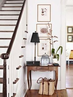 The homeowners found the spindles, newel post, and banister in the offices of a local preservation organization. The hall is decorated with a high-low mix: A custom tiger-maple table pairs with bargains like a terrarium from T.J. Maxx and artwork scored on eBay.