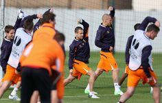 Joe Cole of Liverpool stretches during a training session ahead of their UEFA Europa League match against Udinese Calcio at Melwood Training Ground on October 3, 2012 in Liverpool, England