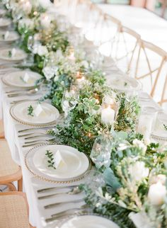 Greenery wedding table: http://www.stylemepretty.com/2017/02/28/this-just-might-be-the-prettiest-ceremony-spot-youll-ever-lay-eyes-on/ Photography: Vasia Han - http://www.vasia-weddings.com/
