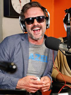 What's so funny?! David Arquette, in masculine square sunnies, was all smiles and laughter while guest starring on a New York radio show!