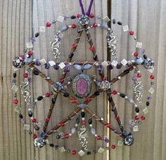 Night Dragon. Handcrafted pentacle by KM Fields' Elemental Enchantments. Custom piece for Marylue. Willow branches, wire, metal beads, glass beads, amethyst beads, hematite beads, shell beads, dragon charms and purple pendant.