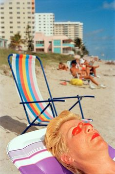 A woman tanning on the beach, Florida, United States, 1997, photograph by Martin…