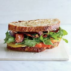 This incredible BLT is made with just a handful of ingredients: crisp bacon, juicy tomatoes, arugula, creamy aioli and toasted sourdough. The result is a perfect bite of summer Blt Recipes, Sandwich Recipes, Wine Recipes, Cooking Recipes, Sandwich Ideas, Recipies, Bacon Sandwich, Soup And Sandwich, Empanadas