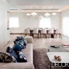 Projeto de renovação assinado pelo Annette Frommer Interior Design Studio propõe mescla de estilos, cores neutras e mobiliário acolhedor.