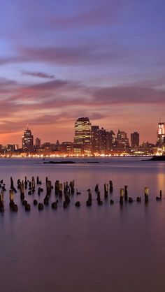 usa, jersey city, new jersey, evening, orange, sunset, purple, sky, skyscrapers, lights, river, hudson, wooden, poles