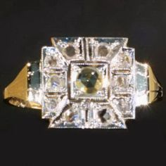 Art Deco ring with rose cut diamonds and made in 18K two tone gold $914 ca. 1930