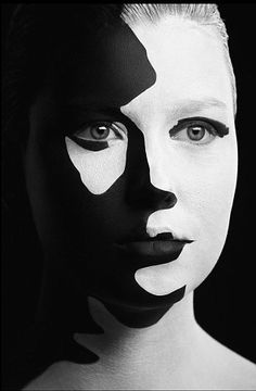 White Face Painted Fashion | ... model's face in white paint before applying layers of black paint
