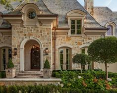 Love the roof line and the french doors across the front of the house!  Gorgeous!