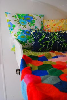 Crazy mixed vintage patterns and colors are awesome, exposed electrical outlet is not awesome