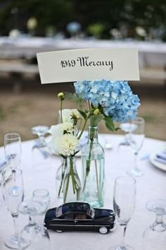 Classic car table name with little model car to match. Wedding Coordination by Caitlin Arnold Weddings and Events. Photo by Thousand Words Worth Photography.