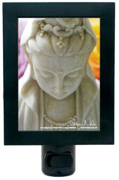 Kwan Yin is the goddess of love and compassion. Add beauty and peaceful energy to your sacred space with this serene Kwan Yin night light by Robyn Nola.