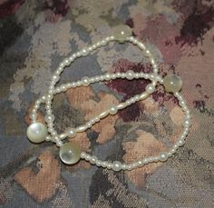 Faux pearl and button stretch bracelet by HandmadeShelley on Etsy
