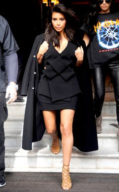 Kim Kardashian is picture perfect at Paris Fashion Week in this all-black ensemble. LOVE the pairing of chic, strappy shoes!