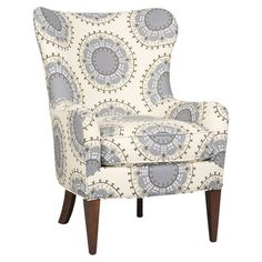 Wingback arm chair with medallion-print upholstery and espresso-finished legs. Made in the USA. Product: ChairConstr...